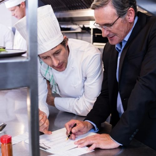 Image of Restaurant Manager Working With Chef